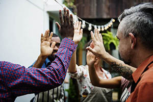 group of people high-fiving each other